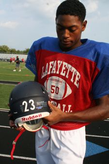 Lafayette High School senior and team captain, Kylan Nelson, has an anti-bullying sticker on his helmet. (Photo by Tammy L. Lane)