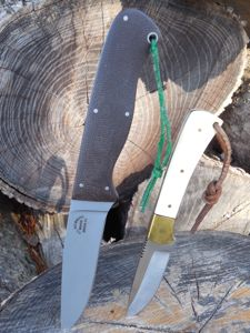 These two knives are handmade in Kentucky. The one on the left is a fixed blade knife made by Kentucky maker H. L. Holbrook. The one on the right is a fixed blade knife made by Kentucky maker Ed Wallace. (Photo by John Lander)