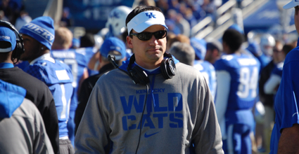 Would Kentucky offensive coordinator Neal Brown's offense be threatened by a proposed rule change to stifle fast offenses? (Photo by James Pennington)