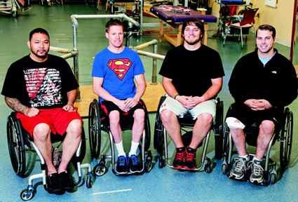 From left is Andrew Meas, Dustin Shillcox, Kent Stephenson and Rob Summers, the first four to undergo task-specific training with epidural stimulation at the Human Locomotion Research Center laboratory, Frazier Rehab Institute, as part of the University of Louisville's Kentucky Spinal Cord Injury Research Center. (Photo from Christopher & Dana Reeve Foundation)