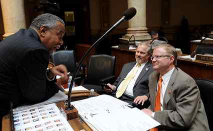 Sen. Gerald Neal, D-Louisville, confers with Senate Majority Floor Leader Damon Thayer, R-Georgetown (right), in the Kentucky Senate as Sen. Mike Wilson, R-Bowling Green, looks on.