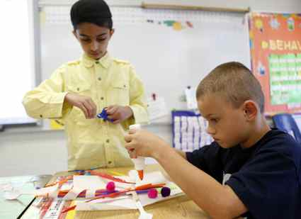 Mustfa Malik and Chase Smith work together building their design of an animal that could transfer pollen during Debbie Lewis' second-grade class at Morningside Elementary School in Elizabethtown. (Photo by Amy Wallot)