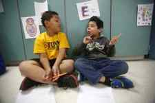 Second-grade students Terrence Turner Brown and Samuel Tress share ideas. (Photo by Amy Wallot)