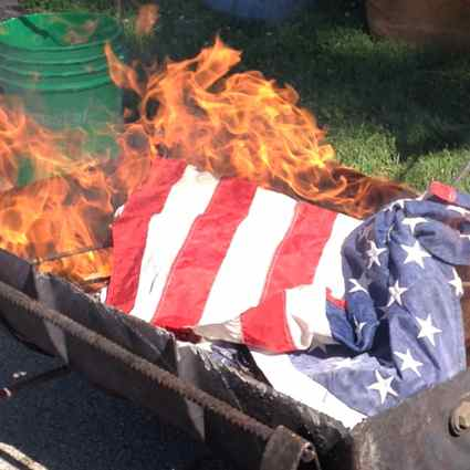 American flags are burned until unrecognizable (Photos by Kristy Robinson Horine)