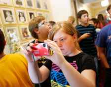 Fifth-grade student Mary-Grace Walling photographs a grandfather clock. (Photo by Amy Wallot)