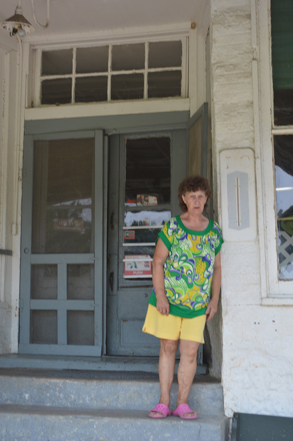 Carolyn Jones on the steps of Jones Grocery (Photo by Andy Mead)