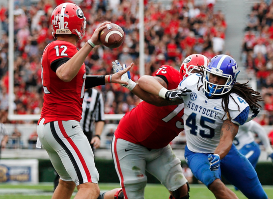 Kentucky linebacker Josh Forrest pressures Georgia quarterback Brice Ramsey in a 27-3 loss to the Bulldogs last week in Athens. Kentucky closes the road portion of the schedule Saturday at Vanderbilt. Kickoff is set for 4 p.m. (Photo by UK Athletics)