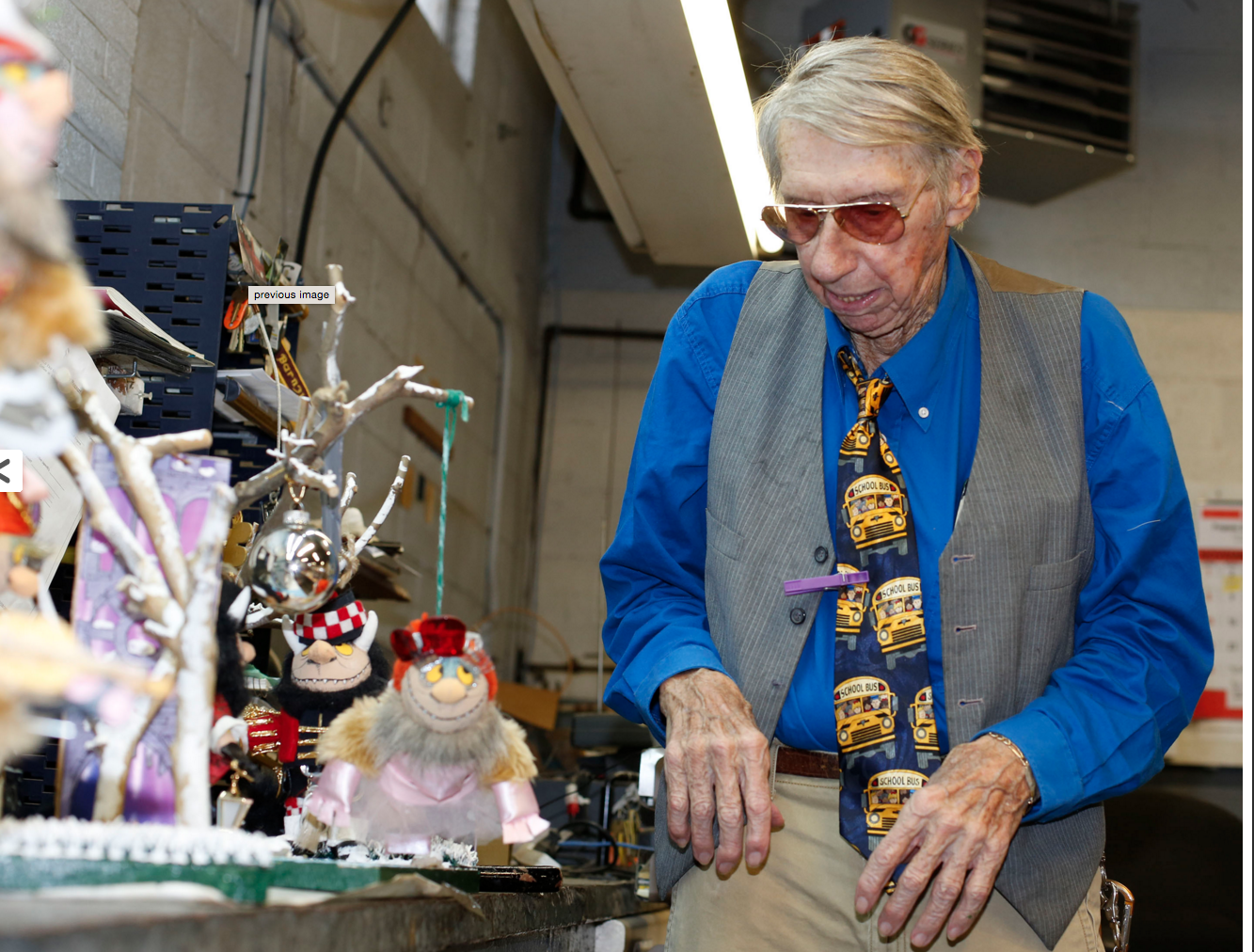Doug Ahrens displays in the Bourbon County bus garage some of the scenes from 'The Nutcracker' ballet that he recreated using dolls.