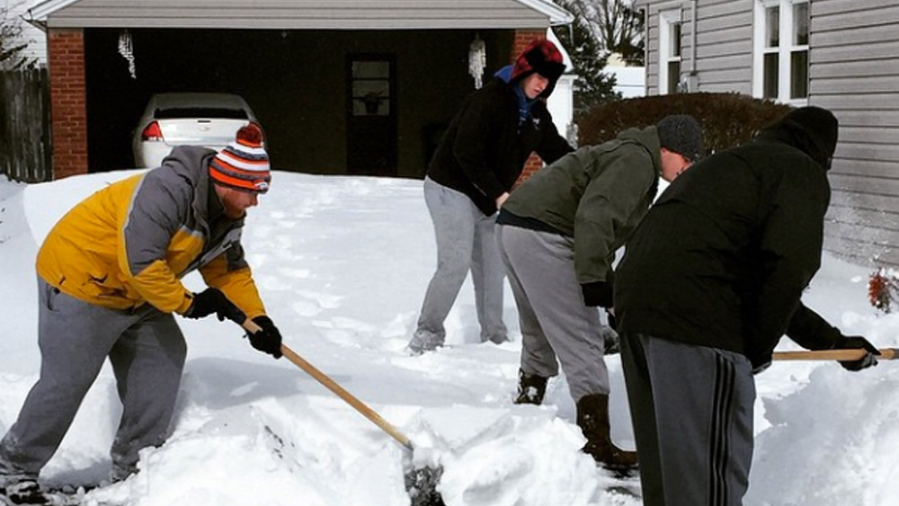 Centre football players shovel snow for a neighbor in Danville.