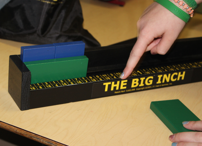 The Big Inch features colored blocks that students can manipulate into various combinations corresponding with math equations.