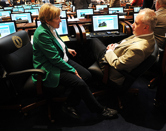 Rep. Mary Lou Marzian, D-Louisville (left), confers with Rep. Adam Koenig, R-Erlanger, during a recess period in the Kentucky House of Representatives (LRC Public Information Photo)