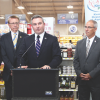 griculture Commissioner Ryan Quarles announces the launch of the Kentucky Proud initiative in Houchens-owned grocery stores as (from left) state Reps. Michael Meredith, Jody Richards, Jim DeCesare, and Wilson Stone look on. (Kentucky Department of Agriculture photo)