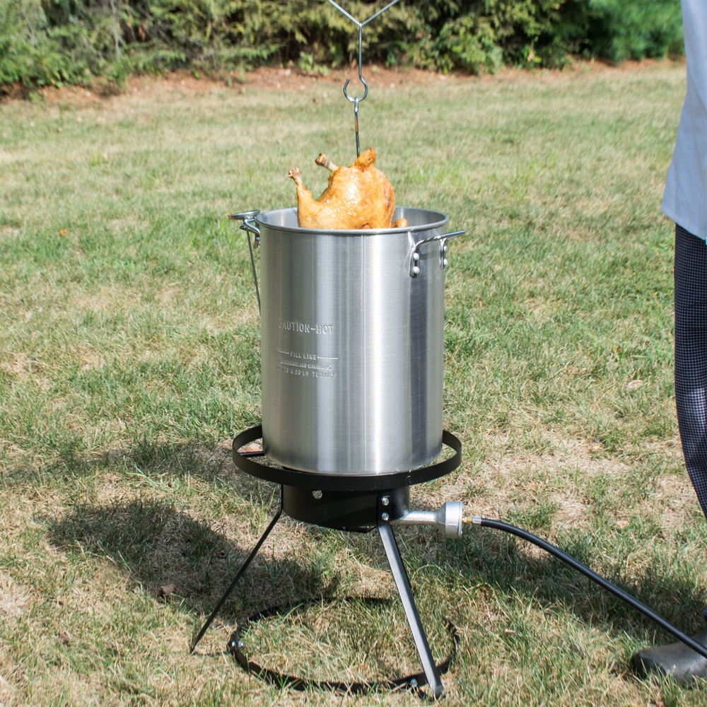 keven moore preparing holiday turkey in a fryer adds element of