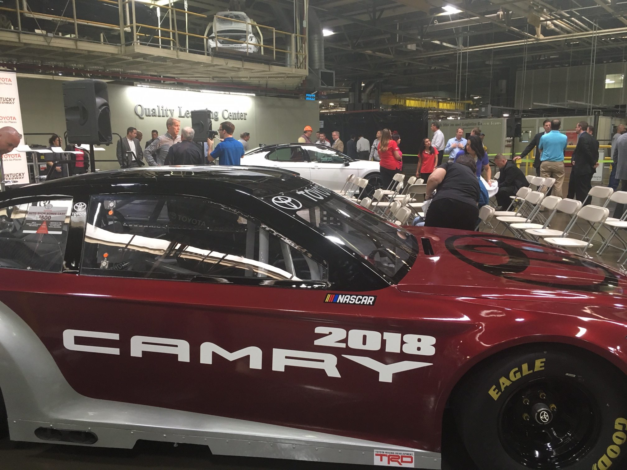 A 2018 nascar toyota camry sits in front of the white prototype vehicle that will be available for consumers soon one of toyota s goals is to make the