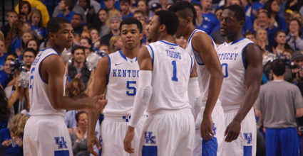 Andrew Harrison (No. 5) and James Young (No. 1) had important offensive plays to keep Kentucky in the game Tuesday against Arkansas, but their defensive lapses cost the Wildcats. (File photo by James Pennington)