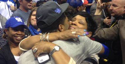 Andrew Harrison hugs his mother, Marian, following Kentucky's Final Four-clinching win over Michigan on Sunday. (Photo by James Pennington)