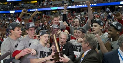 Wisconsin has made it to the Final Four largely on the back of 7-footer Frank Kaminski (back, both arms raised). Wisconsin plays Kentucky in the Final Four on Saturday. (Photo by David Stluka, courtesy of Wisconsin Athletics)