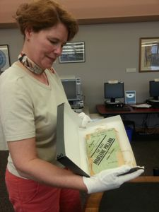 Virginia McClure, manager of the Lexington Public Library's Kentucky Room, displays the original ' (Photo from LPL)
