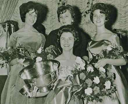A photo of the punch bowl being presented to the first Miss Keeneland, Mary Ann Tobin, can be found in the 1963 Kentuckian yearbook. The award was presented at the residence hall's Christmas formal held at Lafayette Hotel. In addition to her name being inscribed on the bowl, Tobin received a small bowl to keep herself. (Photo from UK)