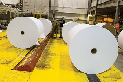 aper rolls fresh off the assembly line are ready to be shipped. Each roll weighs about 3 tons. (Photo from UK's mAGazine)