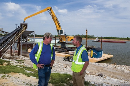 Bruce Cabbage, operations manager for Owensboro Riverport Authority, speaks with Clint Hardy, Daviess County ANR extension agent. The riverport imports more than 250,000 tons of fertilizer a year. (Photo from UK's mAGazine)