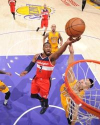 John Wall has seen his scoring average dip a bit this season, but he is leading the NBA in assists (NBA.com Photo)