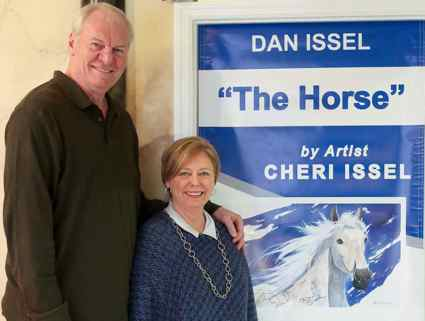 Dan and Cheri Issel next to her piece, 'The Horse'  (Photo from UKNow)