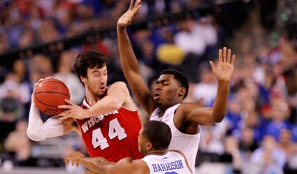 Kentucky's Dakari Johnson and Aaron Harrison apply defensive pressure to national Player of the Year Frank Kaminsky during Saturday's semifinal game (UK Athletics Photo / Chet White)