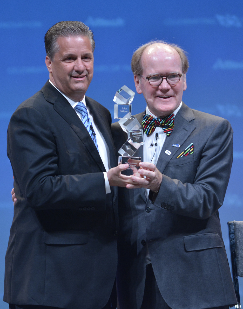 John Calipari accepts the 2015 Humanitarian Award from Dr. Pearse Lyons, president and founder of Alltech. Calipari was honored at the Alltech REBELation international conference for his commitment to philanthropic initiatives (Alltech Photo)