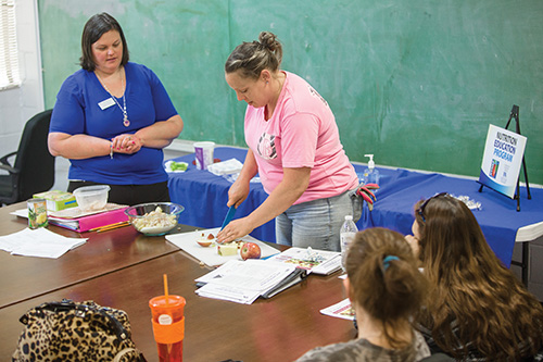 Nutrition classes led by Kacy Wiley, left, have changed the way Ali Sanders shops and cooks. (Photo by Stephen Patton)