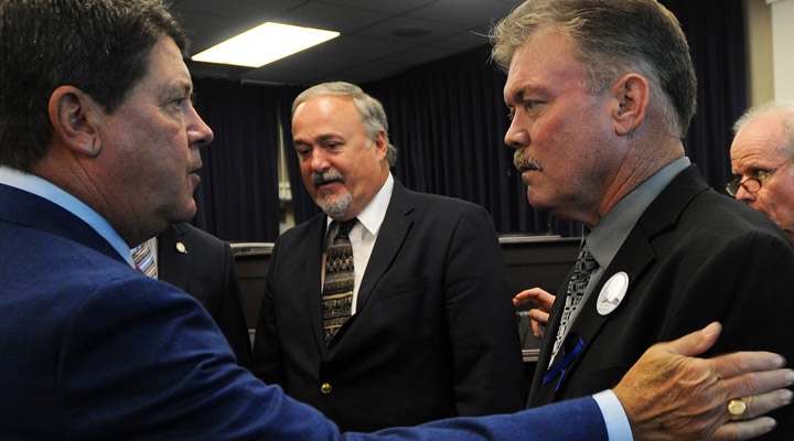 Kentucky House Speaker Greg Stumbo talks to Joe Ponder, father of slain Kentucky State Trooper Joseph Cameron Ponder, during a press conference in which they and other legislators called for increased safety measures for officers. (LRC Public Information photo)