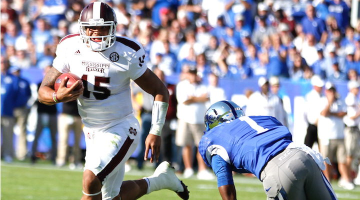 Mississippi State quarterback Dak Prescott escapes Kentucky's A.J. Stamps during the Bulldogs' 45-31 win over the Wildcats last year at Commonwealth Stadium. The two teams meet in a 7:30 p.m. kickoff Saturday in Starkville (Glenn Morris Photo)