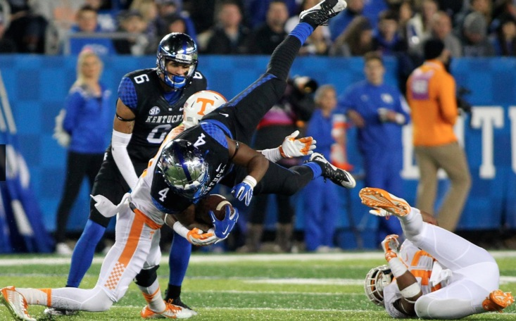 Kentucky running back Mikel Horton gets tackled by a Tennessee defender Saturday night (UK Athletics Photo)