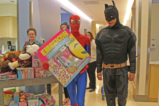 After raising about $1,500 to buy more than 100 toys for young patients, the students made their way from room to room handing out teddy bears, board games, dolls, and soccer balls (Photo Provided)
