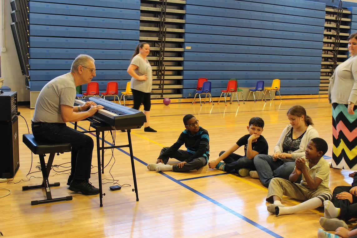 Frank Messina, a retired arts-and-humanities teacher, played a series of notes on his keyboard and asked the students to echo the rhythm by clapping (Photo Provided)