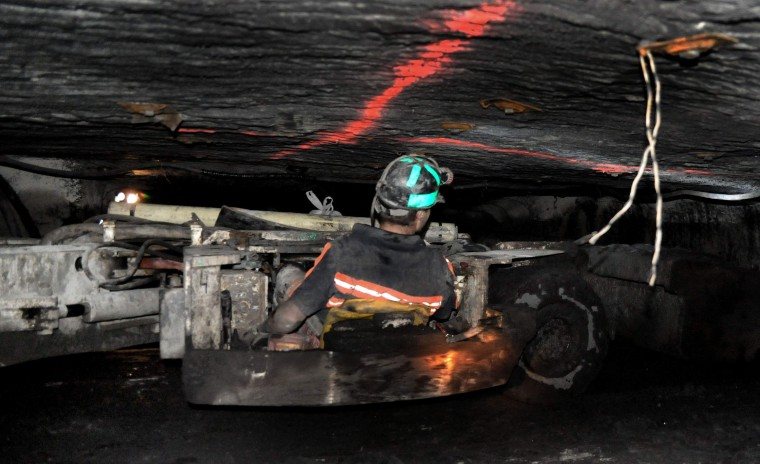 A miner operates a scoop (West Virginia Gazette Photo from Daily Yonder)