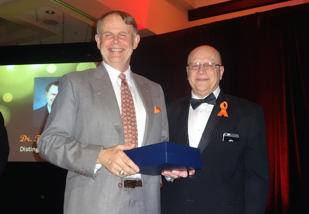 Dr. Thomas Waid (left), professor in the University of Kentucky College of Medicine, received the Distinguished Physician Award from the National Kidney Foundation (UK Now Photo)