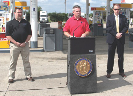 Agriculture Commissioner Ryan Quarles, center, talks to the Lexington news media about the problem of credit card skimmers in motor fuel pumps. Also participating in the June 27 news conference were Jason Glass, left, assistant director of the Kentucky Department of Agriculture's Division of Regulation and Inspection, and Lexington Police Detective Mike Helsby. (Kentucky Department of Agriculture photo)
