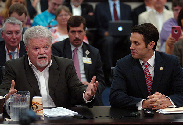 (Left to Right) Sen. Perry Clark, D-Louisville, discusses future legislation on medical marijuana as Sen. Morgan McGarvey, D-Louisville, listens during the July 8th meeting of the Interim Joint Committee on Licensing and Occupations (LRC Public Information Photo)