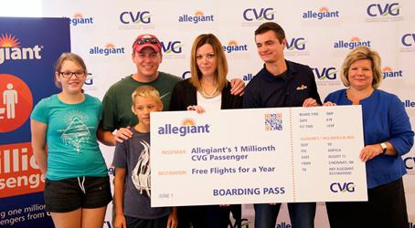 Angela Stewart and family are the one millionth Allegiant passengers at CVG. CVG Chief Executive Officer Candace McGraw is at right (Photos Provided)