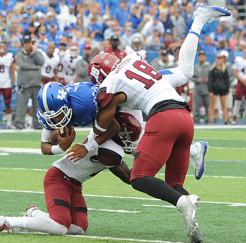 UK quarterback Stephen Johnson leaps for an extra yard in a win over New Mexico State Saturday (Bill Thiry Photo)